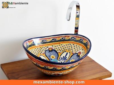 <p>Ovales handbemaltes Handwaschbecken MEX7 Maya von Mexambiente. Mediterranstil Aufsatzwaschbecken</p>